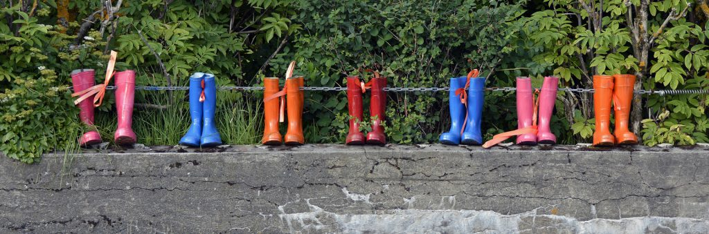 Rubber boots on a wall Put some boots on the ground to get the most out of your hyperlocal real estate marketing strategy.