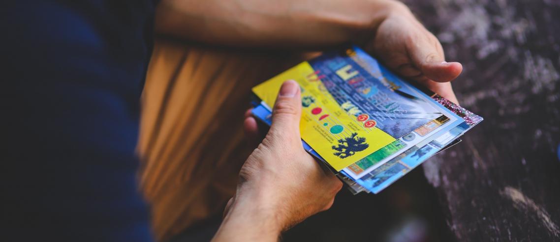Man holding postcards